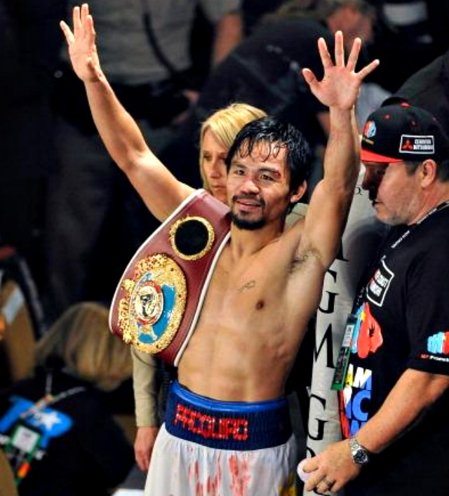 Manny Pacquiao celebrates his victory over Timothy Bradley by throwing kisses to the crowd. Photo: David Becker/Getty Images