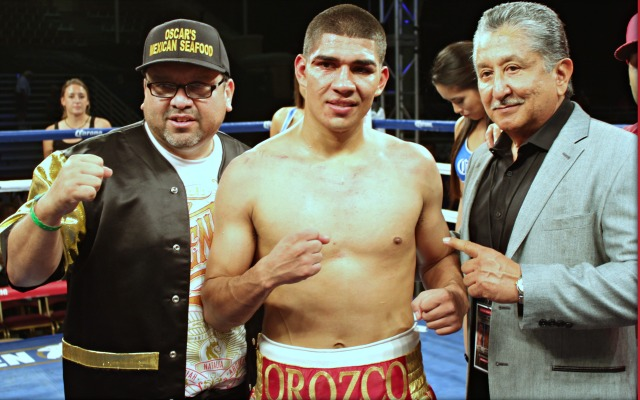 At the conclusion of his bout with Martin Honorio, Antonio Orozco is joined by his trainer Carlos Barragan Jr. (l) and his manager, Frank Espinoza (r). Photo: Jim Wyatt