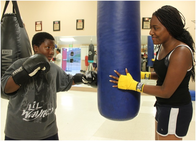 Audrea Carey (r) has made it her mission to make sure her younger brother succeeds in getting
