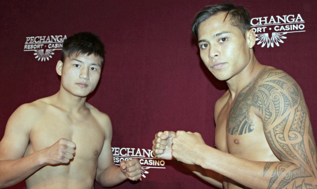 Marvin Madariaga (r0 faces off with his opponent on Saturday, Wei Ninghui.