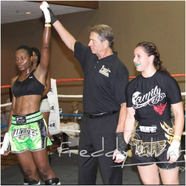 Sharon Patray has her arm raised in victory by referee Jim VanOver after she defeated Kenya Neves (r). Photo: Freddy Alvarez