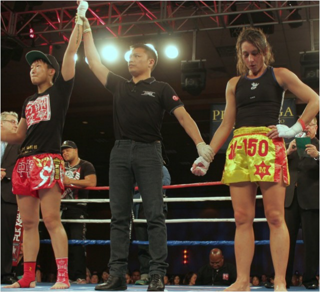 At the conclusion of her bout against Lindsay Ball, Wang Kehan had her arm raised in victory.