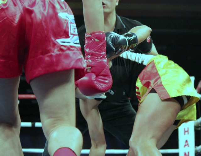 "Wang ""Chaoqi"" Kehan of China lands a solid punch that sends Lindsay Ball to the floor."