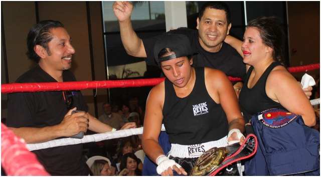 Before leaving the ring, Jeanna Carrillo (r) visits the opposite corner for some well wishing.