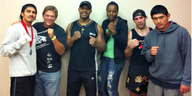 Extreme Power Muay Thai Team of Oceanside (l to r) Allan Gabriel, assistant trainer Ron Di Nicola, Kru Ruben Rowell, Sharon Patray, Michael Jaeger and Jorge Agustin pose for a pre-fight photo in the Sheraton Hotel dressing area.