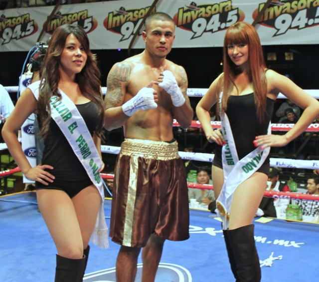To the victor goes the spoils. After his victory over Refugio Contreras, Oscar Godoy was joined by the lovely show hostesses at the Las Pulgas Concert Hall in Tijuana, Mexico.