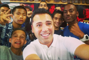 "In a fun mood, the President of Golden Boy Promotions Oscar De La Hoya takes what they call a ""selfie"" of himself and the youngsters who regularly train at the house of Boxing."