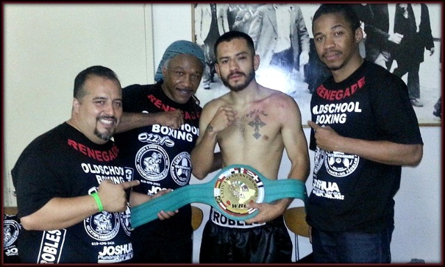 "After another big win, Emmanuel Robles and his support group pose for a photo. (l to r) Juan Ramirez of Cutman4Hire, trainer Ernie ""Too Slick"" Johnson and Johnson's son, Ernest ""Silky"" Johnson Jr."