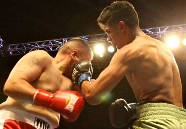 Coachella's Alberto Fundora (r) unloads a short left uppercut to the side of Albert Avina's head in their Light Heavyweight bout at the Fantasy Springs Resort & Casino on Friday, July 11, 2014 in Indio, CA.