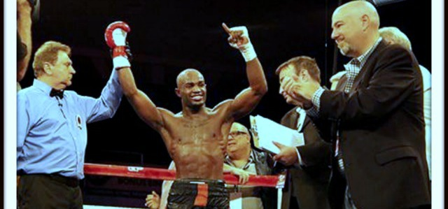 Cecil McCalla of Baltimore, MD has his arm raised in victory by referee Dick Pakozdi after winning an unanimous decision victory over Oscar Godoy of Watsonville, CA.