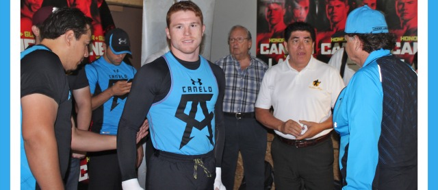 "Surrounded by his support group consisting of two trainers, a family member, his publicist and head of marketing, Saul ""Canelo"" Alvarez gets ready for his workout at The House of Boxing gym in Paradise Hill, San Diego, CA."