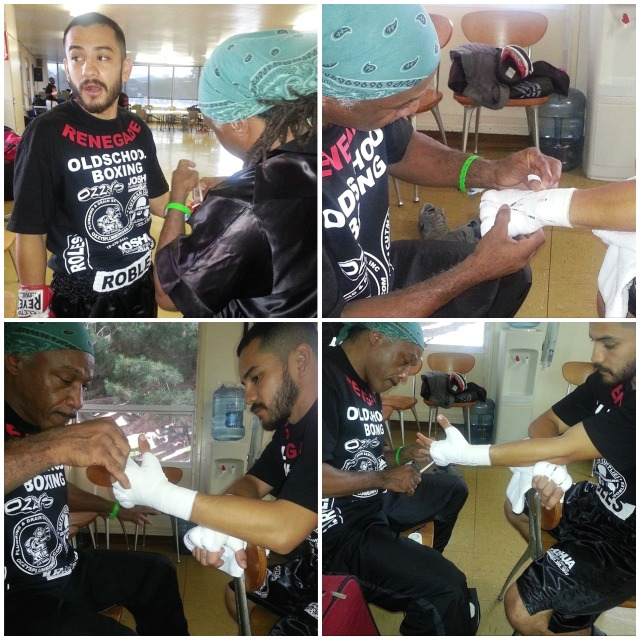 Coach Johnson works slowly but surely on Emmanuel Robles' hand wraps
