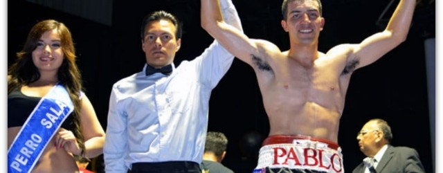Here we see referee Christian Curiel raising the arm of Pablo Armenta after Armenta knocked Hernandez out in round #1 back on March 22, 2012 at Salon Las Pulgas in Tijuana, B. C., Mexico.