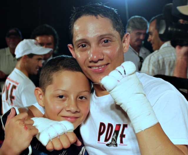 Elvis Trujillo poses for a photo with his son. Photo: Jim Wyatt