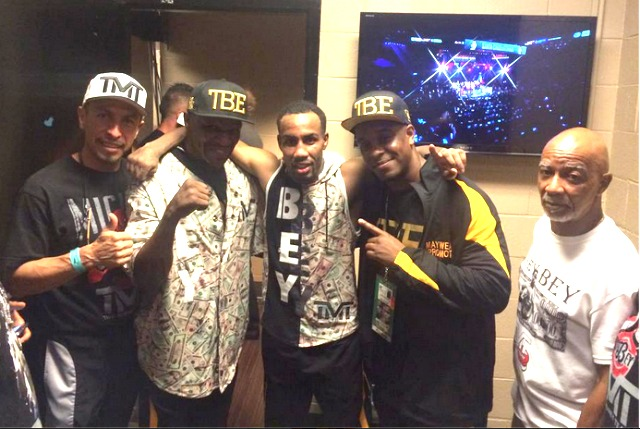 The new IBF Lightweight Champion of the World Mickey Bey poses for a photo with his posse in the dressing room after the big win over Miguel Vazquez.