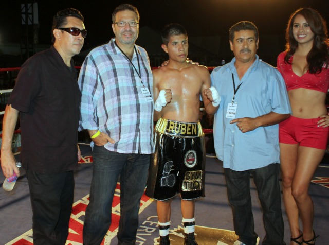 At the conclusion of Bout #5, Ruben Garcia is joined by his co-managers Andy and Jorge Marron. Photo: Jim Wyatt
