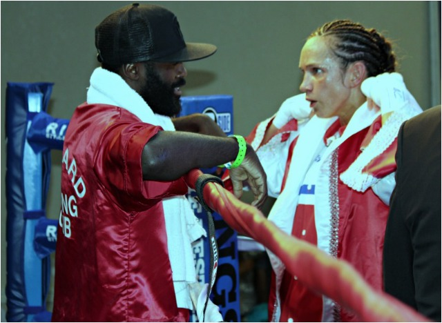 In this photo we see pro boxer Steve Forbes smiling at Brandy Badry who is almost incredulous about what has just taken place - the late knockdown with just one second left in her bout with Jillian Lybarger. Photo: Jim Wyatt
