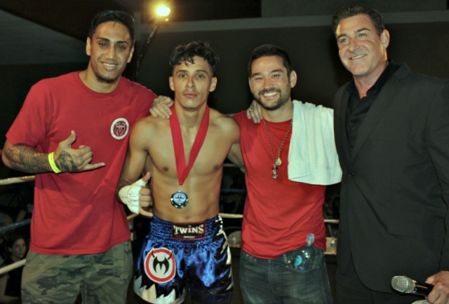 After his victory, Rolando Duron was joined by the show's ring announcer Carlos Kremer and the members of his support group Zac Shepard (l) and Carl Gebhardt (r).
