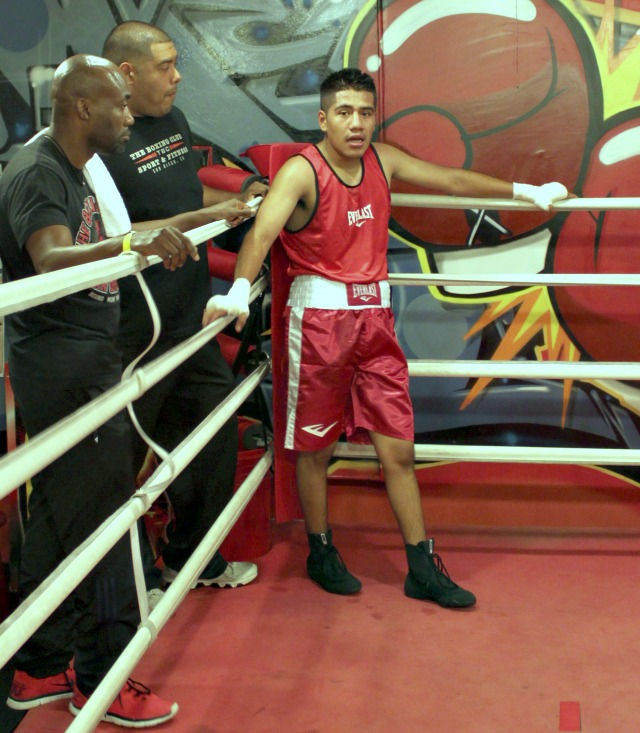 After his bout with Austin Brooks, Carlos Remigio has his photo taken while awaiting the judges' decision.