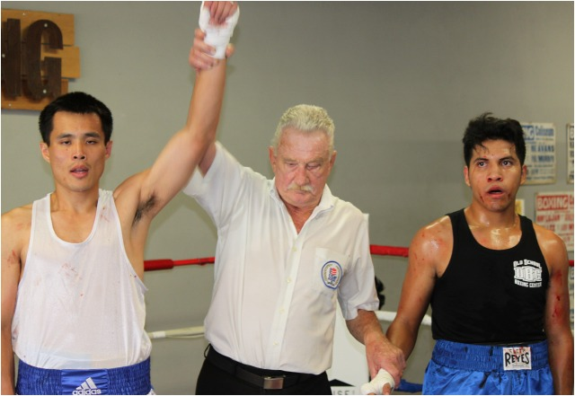 At the conclusion of Bout #11, referee Rick Ley raises the arm of in victory. All photos: Jim Wyatt