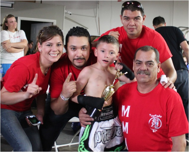 Canelito Kristian poses for a photo with his family after the victory. Photo: J. Wyatt