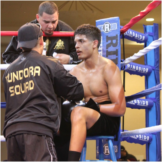 In between rounds, we see Alberto Fundora sitting on his stool getting instructions from his coach.