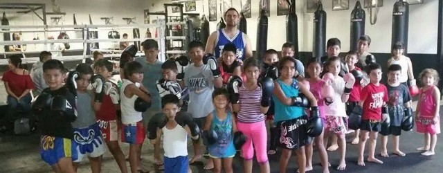 Here we have one of the gym owners, Robert Aldama along with the many youngsters enrolled in the kids Muay Thai program. On Saturday, these youngsters will have to take a back seat to the more experienced fighters who will arrivefrom all over Southern California and parts of Baja California.