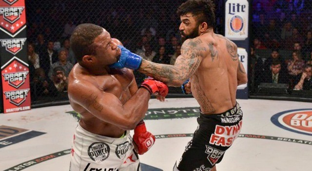 February 28, 2015: What an amazing bout - Liam McGeary (r)  defeats Emanuel Newton to win  the Bellator Light Heavyweight Championship.