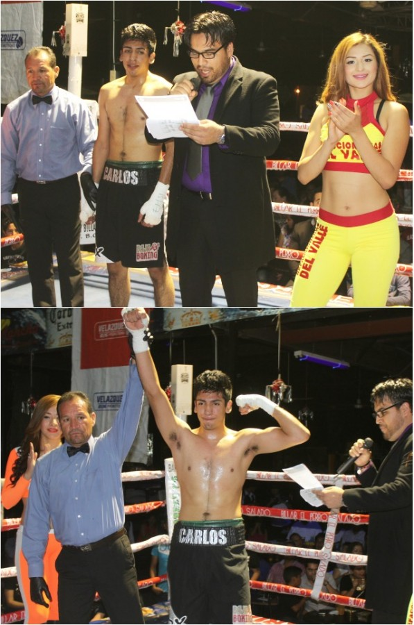 The victorious Carlos Martinez has his arm raised in victory by referee Fernando Renteria.
