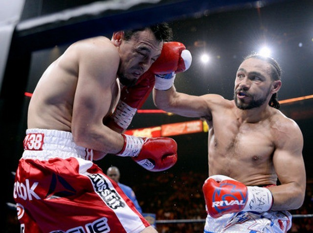 Thurman lands a hard right to Guerrero's head. Photo: Harry How/Getty Images