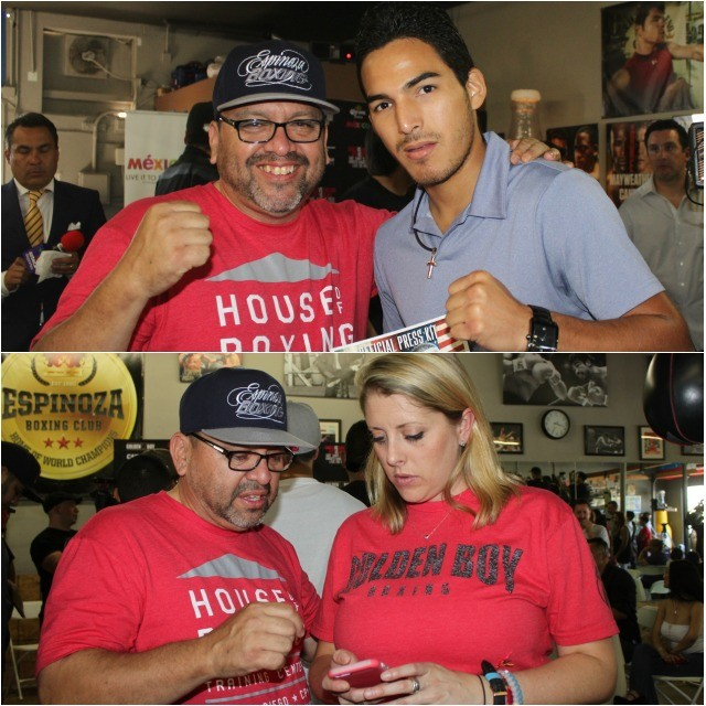 On Saturday, Carlos Barragan was all over the place making sure the Media Day ran smoothly (top) he confers with pro boxer Miguel Sanchez Cuen and below he compares notes with a young lady from Golden Boy Promotions. Photos: Jim Wyatt