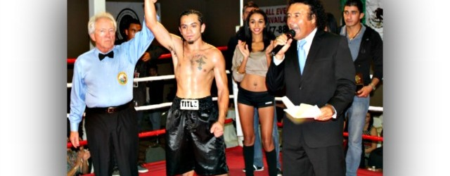 "Emmanuel ""Renegade"" Robles has come a long way since this photo was taken back on November 2, 2012 with Hall of Fame referee Pat Russell raising up his arm in victory and ring announcer Benny Ricardo announcing his victory over Jose Mendoza. Photo: Jim Wyatt"