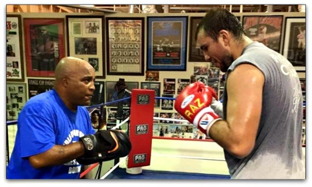 Former boxer, well respected trainer Buddy McGirt (l) holds the mitts for his giant heavyweight.