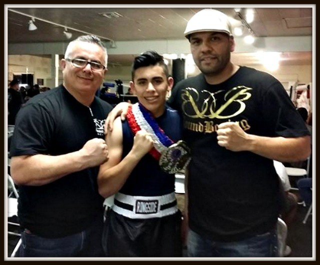 Proud coach and proud father pose for a photo at the conclusion of the bout.