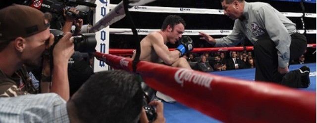 For the first time in his professional boxing career, Julio Cesar Chavez Jr. hears a referee, in this case veteran referee Jerry Cantu, give him the 10-count after being knocked off his feet. All photos: Harry How/Getty Images