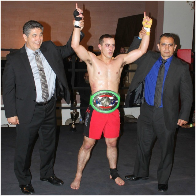 Bruno Borges has his arms raised in victory by Bruno Borges has his arms raised in victory by the show's promoter Victor Beltran and the legendary Miguel Reyes, the Bi-national coordinator of tournaments plus President of the State Assoc. of Thai Boxing & Kickboxing in Baja Calif.
