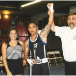 At the conclusion of the final bout of the show, Hondo Fontan, the current President of the USA Amateur Boxing's LBC 44, raises the arm of the victorious Alexander Martinez after he defeated the formidable Tyler Herberger from Old School Boxing.