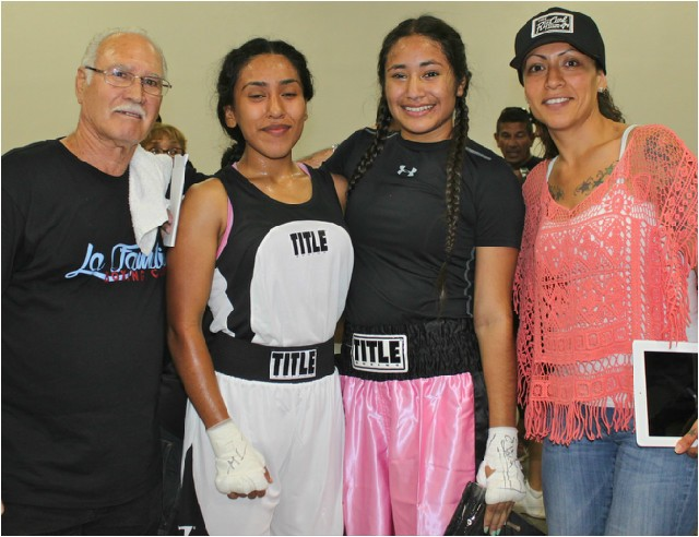 Mom and coach join the boxers at the conclusion of their exciting match.