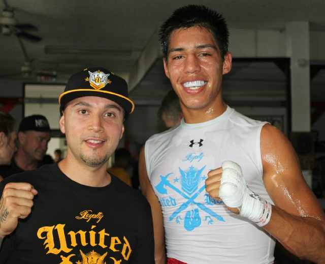 At the conclusion of Bout #1, Brayan Garcia and his coach Marcel Acevedo posed for one last photo.