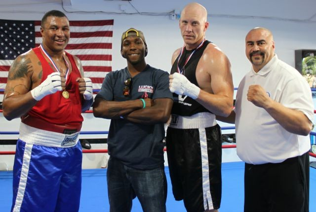 Lucky Invitational, August 15, 2015: Everyone looks forward to a match featuring the Super Heavyweights. On Saturday, in Bout #19 it was Jvon Wallace (l) facing Adam Stewart (r). Also shown: Mixed Martial Artist/Muay Thai fighter Devin Taylor and Hondo Fontan, current President of USA Amateur Boxing's LBC 44. Photo: J. Wyatt