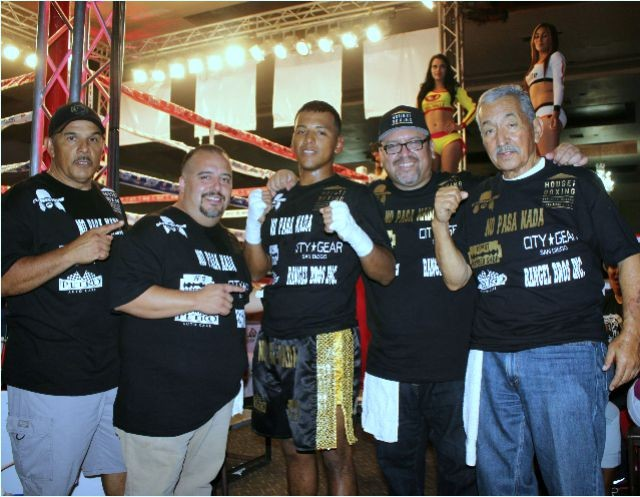 Surrounded by (l to r) Greg Diaz, cutman Juan Ramirez, the victorious Armando Tovar, Carlos Barragan jr., Carlos Barragan, Sr.