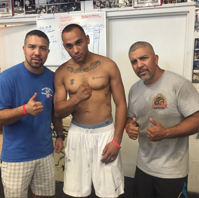 After his big win Jeremy Cullors of the Tiger Smalls Boxing Club had the privilege of posing for this photo with the incomparable Diaz brothers, Joel and Antonio of the Indio Boys & Girls Club.