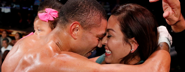 Jose Uzcategui celebrates with his fiance Cathy Maldonado while holding his daughter Krysmar after successfully defeating Julius Jackson at the Cowboys Dance Hall in San Antonio, Texas on October 6, 2015.