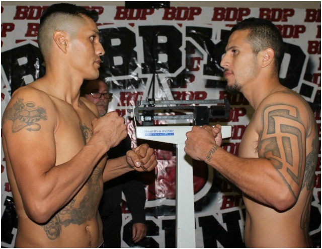 There was a very serious look in both of their faces as Jorge Marquez (l) and Adrian Vargas (r) stood there face to face after their weigh-in.