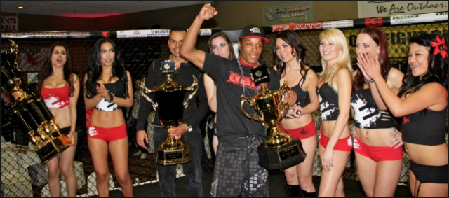 "From the archives comes this January 20, 2012, Epic Fighting 10 photo of Keith ""Danger"" Carson receiving the ""Knockout of the Night"" trophy after stopping Sean Najjar. After the show on Friday, they'll be celebrating their 30th in the series and you know that's going to be a blast. Photo: Jim Wyatt"