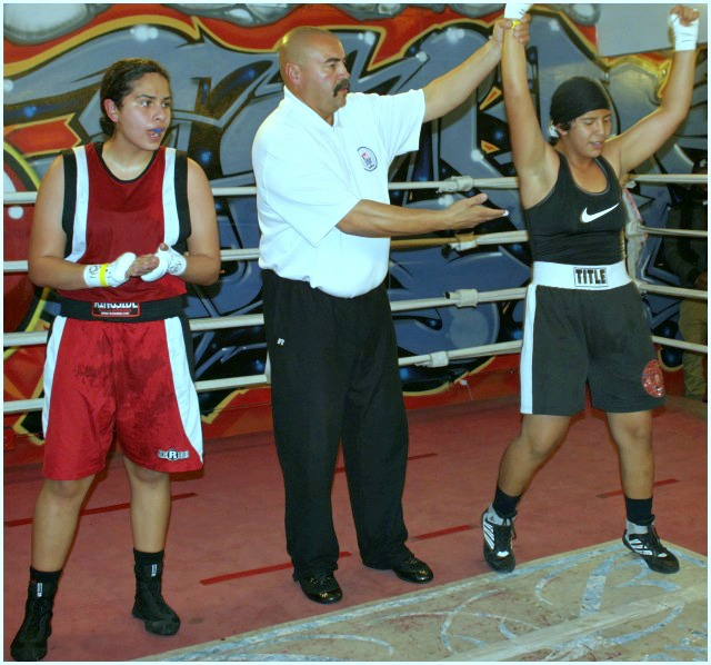 "At the conclusion of Bout #3, we see Citlalli Ortiz having her arm raised in victory by referee Hondo Fontan after she defeated Gabriella ""Gabby"" Gallegos."
