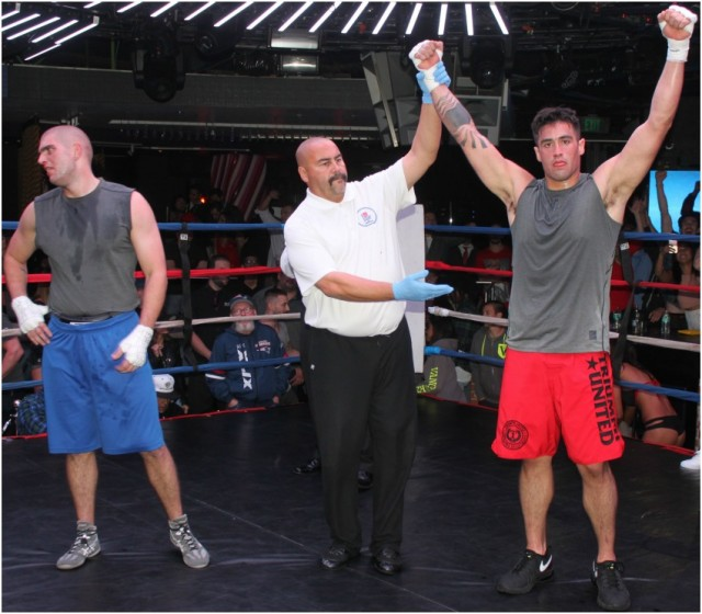 At the conclusion of the final bout, Bout #15, it was Daniel Garcia (right) of Victory MMA having his arm raised in victory by referee Hondo Fondo after earning the decision victory over the tough Thomas Luhta of City Boxing.