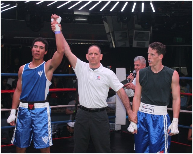 At the conclusion of Bout #1, we see referee Dana Kaplan raising the arm of the victorious David Gates (l) who managed to secure the TKO victory over John Butts.
