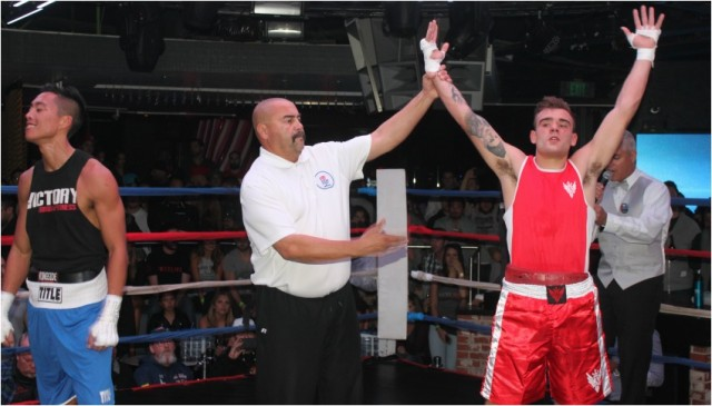 At the conclusion of Bout #2, we see referee Hondo Fontan raising the arm of the victorious Albani who outscored Dingsen