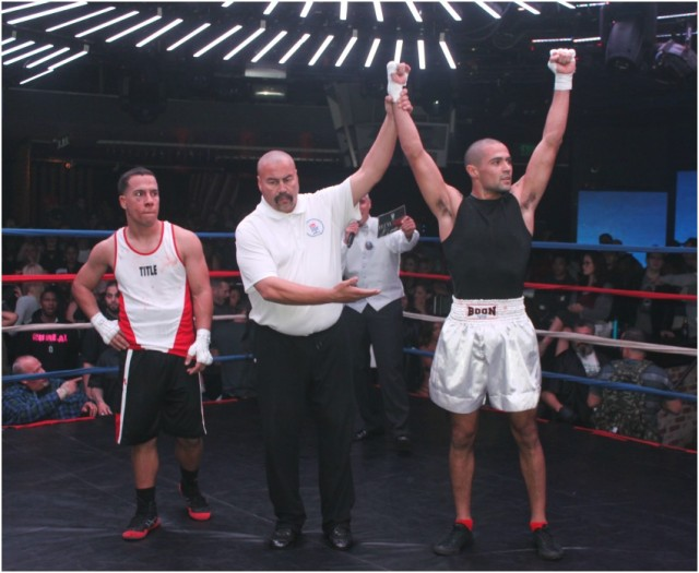 At the conclusion of Bout #5 we see referee Hondo Fontan raising the arm of the victorious Arjuna Arreola who earned a TKO victory over Henry Fuentes. Fuentes
